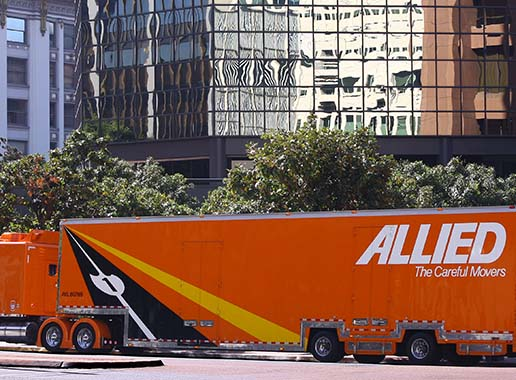 Allied Van Lines agents, Piepho Moving & Storage, and their corporate moving truck in front of office building