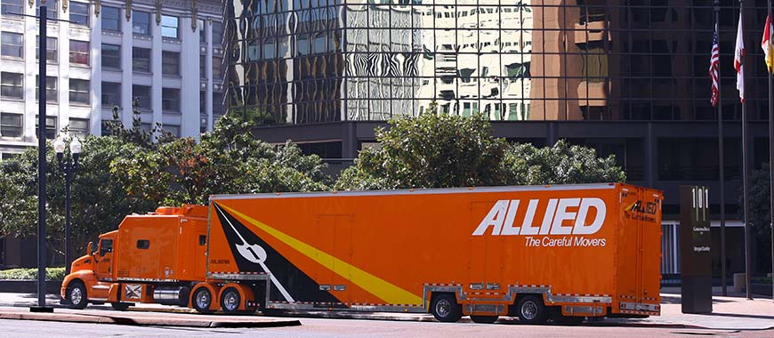 Allied Van Lines corporate moving truck in front of office building
