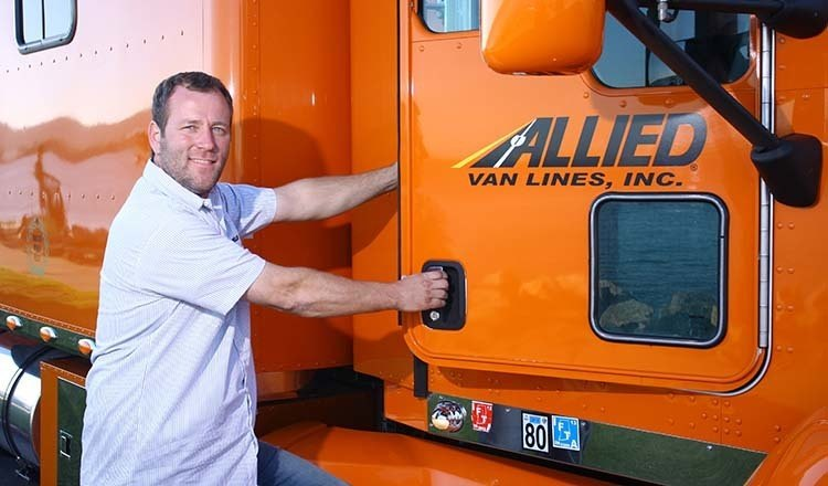Piepho Moving and Storage driver about to get into Allied Van Lines mover truck