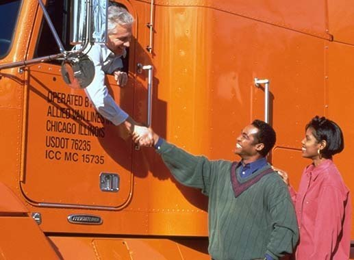 Allied Van Lines Truck Driver shakes hands with residential moving customers serviced by Piepho Moving & Storage