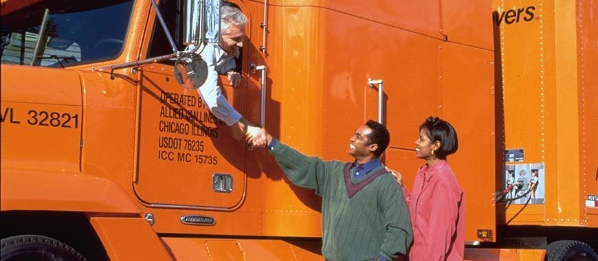 Allied Van Lines Truck Driver shakes hands with Piepho Moving & Storage customers