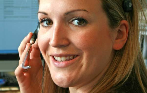 Allied Van Lines agent, Piepho Moving and Storage, Move Coordinator with phone headset talks to a mover