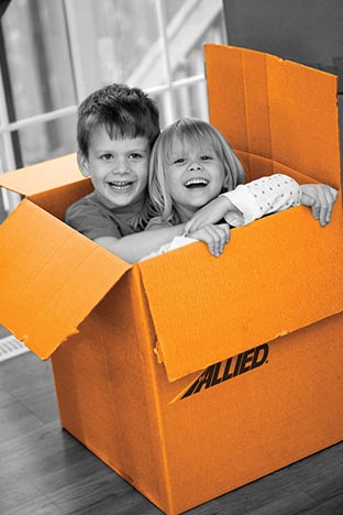 Box with Allied Van Lines logo on the side with moving family's children playing in them