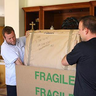 Piepho Moving and Storage, Allied Van Lines agent, packing fragile home furnishings for La Crosse Wi movers