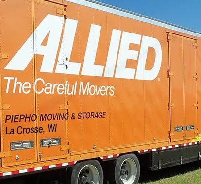 The Allied Van Lines logo and lettering showing La Crosse Wi, Piepho Moving & Storage on the back of the movers truck.