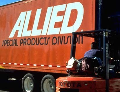 Allied Van Lines Corporate Logistics Services loads a moving truck with a forklift.